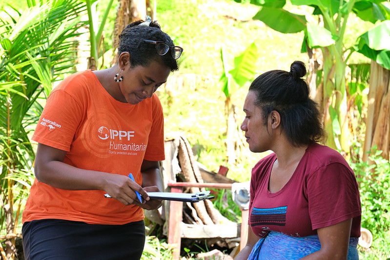 Humanitarian healthcare worker with a client