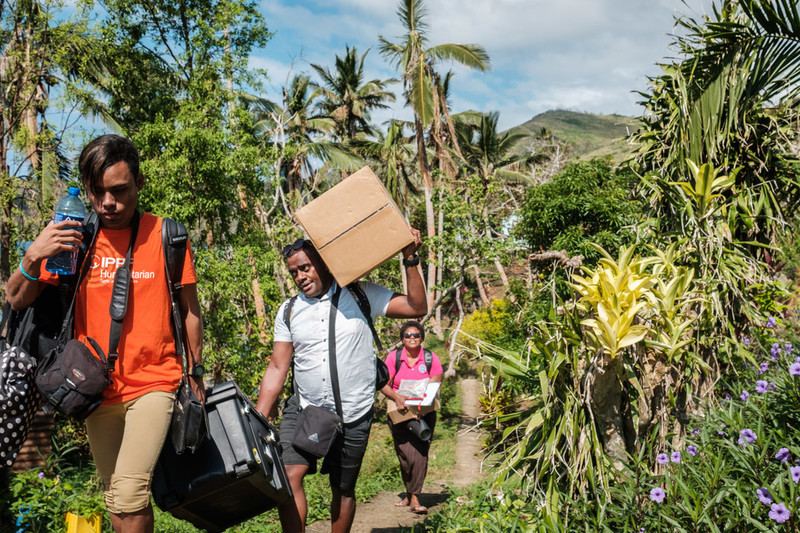 Healthcare workers walking with supplies