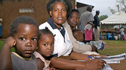 An IPPF MA staff member with a family in Uganda