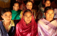 A group of young Bangladeshi girls sit together