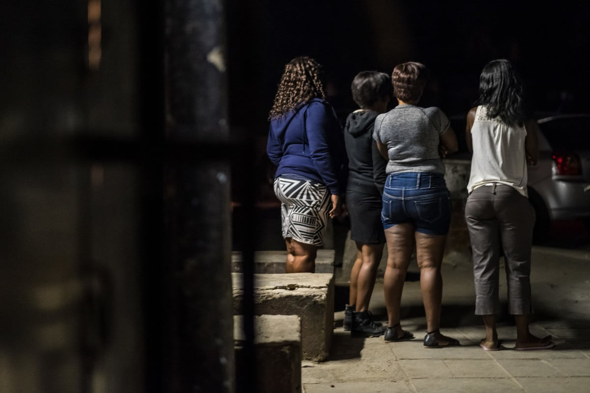 A group of sex-workers wait for clients near a complex of bars in Selebi Phikwe, Botswana.