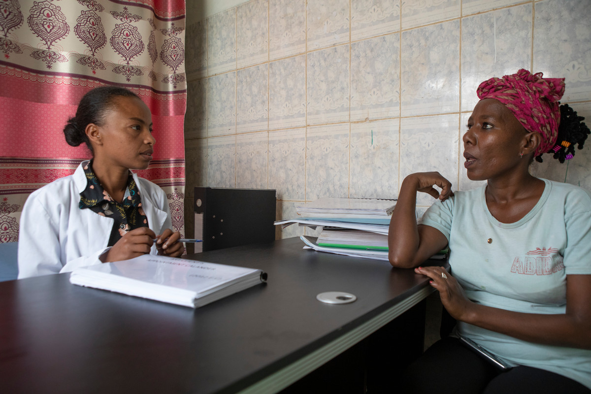 Emebet Bekele is a former sex worker turned counsellor in her office with a patient