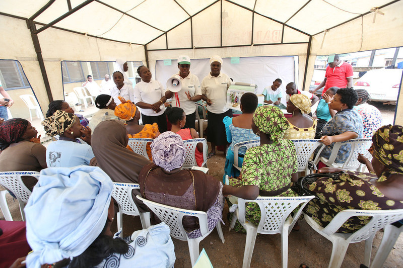 Mrs Oduola Tayo PPFN regional clinic officer, together with other medical officers educate women on family planning methods during a PPFN outreach programme at the Eni Ayo clinic in Ibadan, South West Nigeria