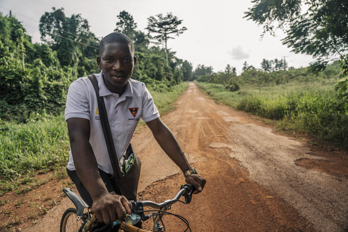 Michael Awuni, 20 peer educator and a student at Ghana Greentech Academy cycles home from school