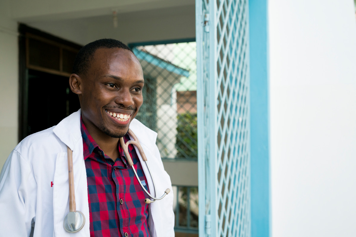 Clinical Officer Adillahi Ali, age 30, stands for a portrait in front of The Family Care Medical Centre (FHOK) in Malindi, Kenya