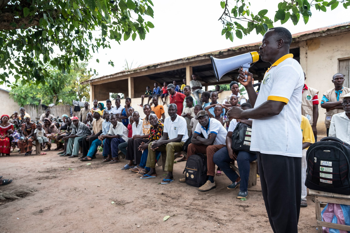 Villagers attend the ATBEF event about about contraception and family planning in Ilama, Togo.
