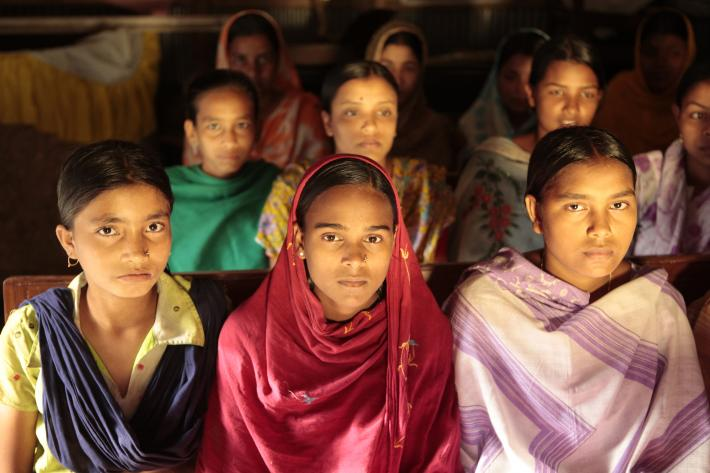 Bangladeshi girls sitting together in a row