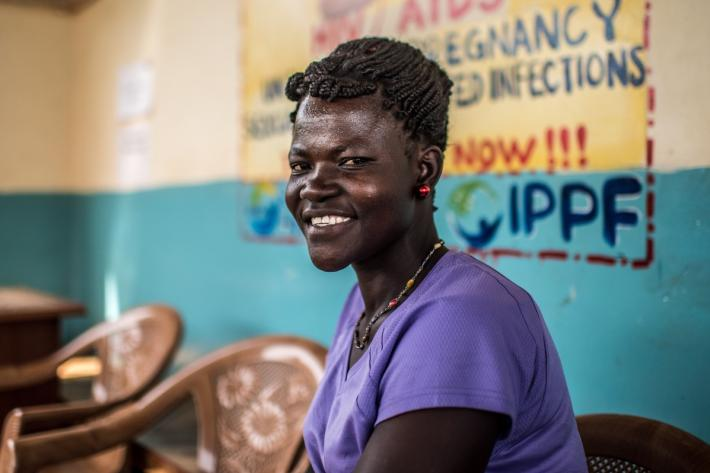 IPPF client from Uganda smiling, waiting for services
