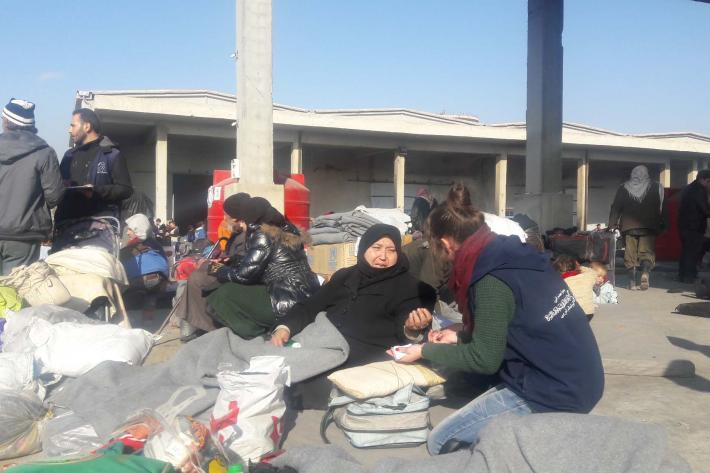 Staff of Syrian Family Planning Association distributing essentials to women.