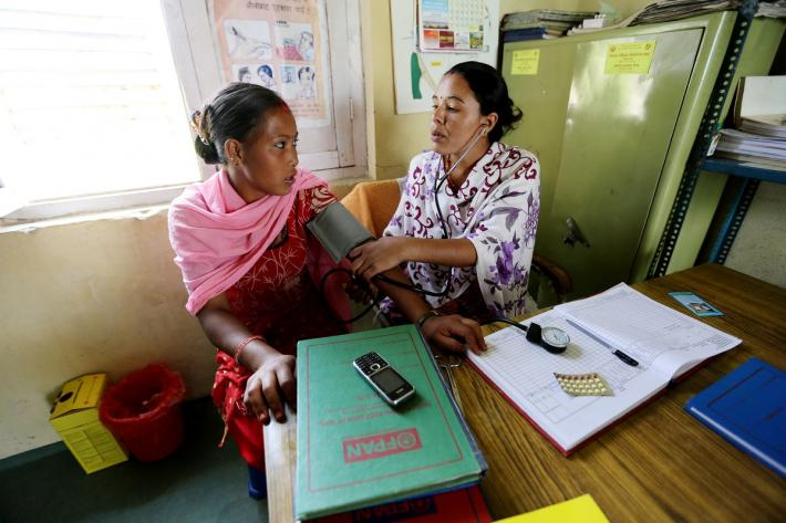 Woman getting health screening from IPPF clinic in Nepal