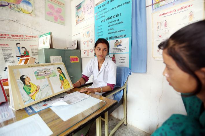 IPPF clinician and female client in Nepal getting sexual health services