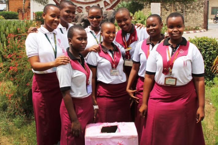 School girls with their pink box for sanitary pads