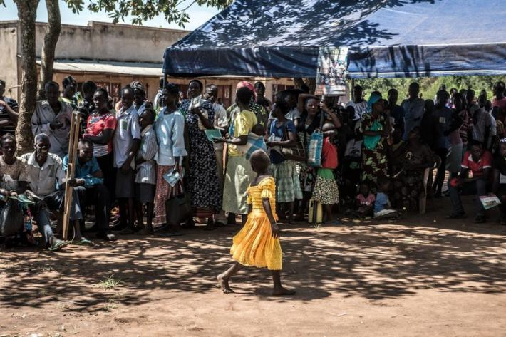 Queues of children, men and women wait in line at a clinic in Gulu, Uganda
