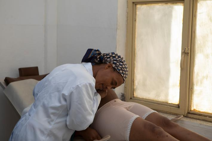 a midwife attends to a pregnant woman in a clinic - Ethiopia