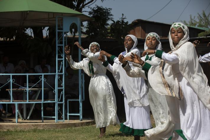 young people in Ethiopia perform a dance at a workshop on sexual health