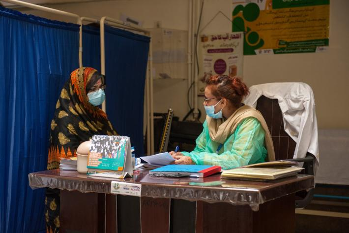 A photo from Pakistan of a woman receiving healthcare