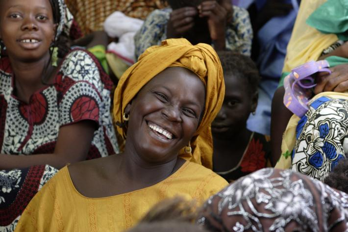 Smiling Mauritanian woman in crowd