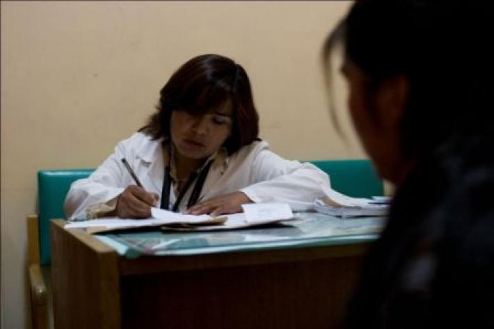 Girl having consultation in Bolivian clinic