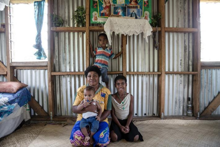 "31 year old Elenoa with her children in her house in village Navala in Ra Province. ""At the time of Cyclone Winston I was seven-months pregnant. It was already very hard trying to keep my other three children safe. I was alone with them because my husband went out hunting before the cyclone hit."""
