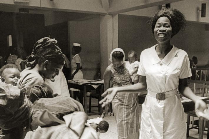 Family planning nurse answering questions at a meeting. Nigeria, 1969