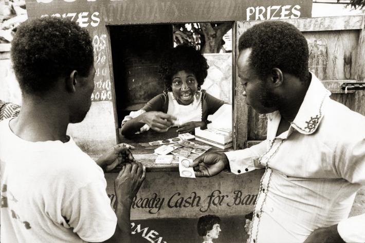 Distributing condoms at a lottery kiosk in Accra. Ghana, 1976