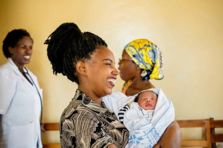 Josiane, 34, finishes her check-up with midwife Regine at ABUBEF clinic in Bujumbura.