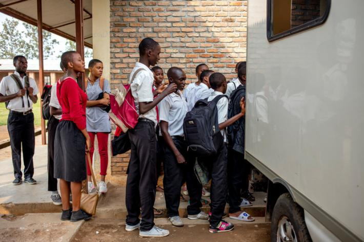 Students wait for their HIV test results outside the ABUBEF mobile clinic van at Municipal Lycee of Nyakabiga school in Bujumbura.
