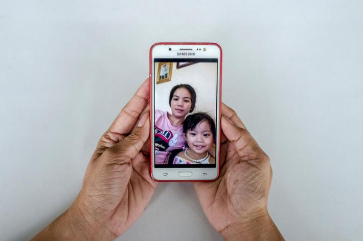 Garment worker Sek Sophorn, 34, shares a photo of her with her 4-year-old daughter Kanika during a break.