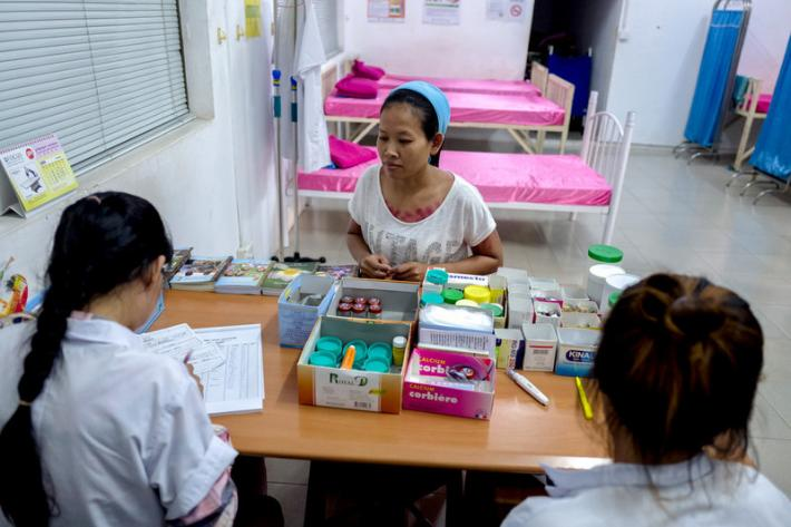 39-year-old garment worker Theary receives a consultation at the Propitious garment factory. RHAC provides training to some of the nurses working in the factories as part of their programmes, so that garment workers can seek advice during working days about reproductive health issues.