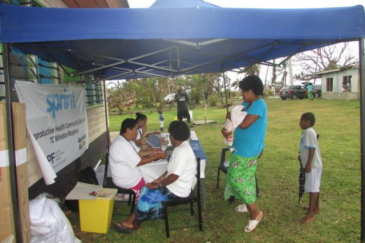 Our staff on the ground providing clients with sexual health services via mobile outreach pop-up clinics.