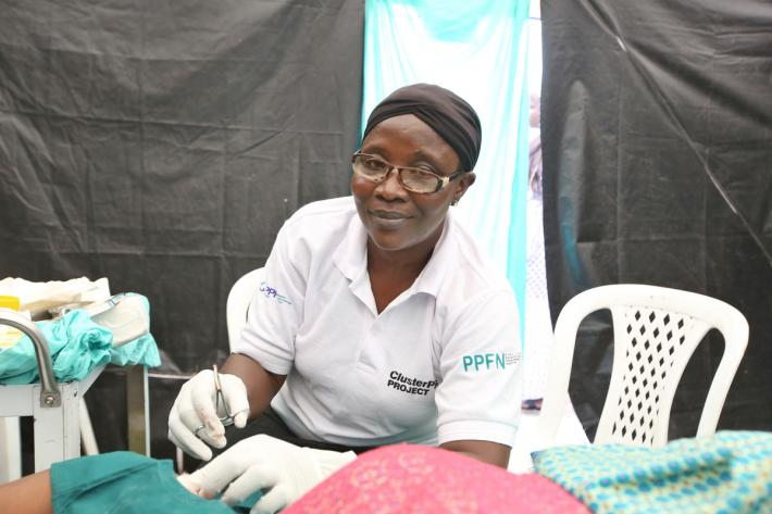IPPF public health facility worker administers family planning to local clients