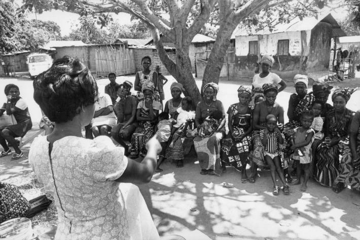 Family planning health workers giving a talk to a local community on contraception. Ghana, 1976
