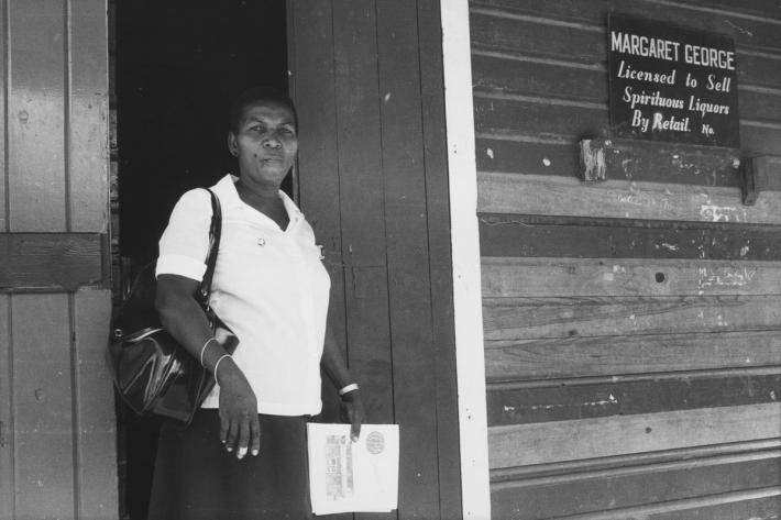 Margaret George, one of two GPPA community outreach workers, outside her shop which distributes contraception to the local community. Grenada, 1982