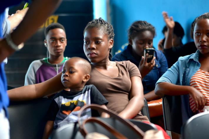21-year old Jenny Marcelino* and her three-year old son wait for free counselling, tests and treatment at the Amodefa clinic in Maputo.