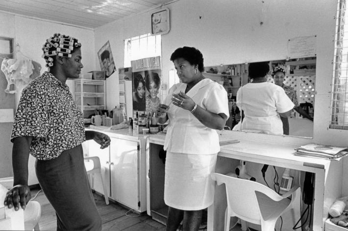 Juliette Simon, counsellor, talking with the owner of a local village hairdessers who is also a community distributor for contraception. St Lucia, 1994