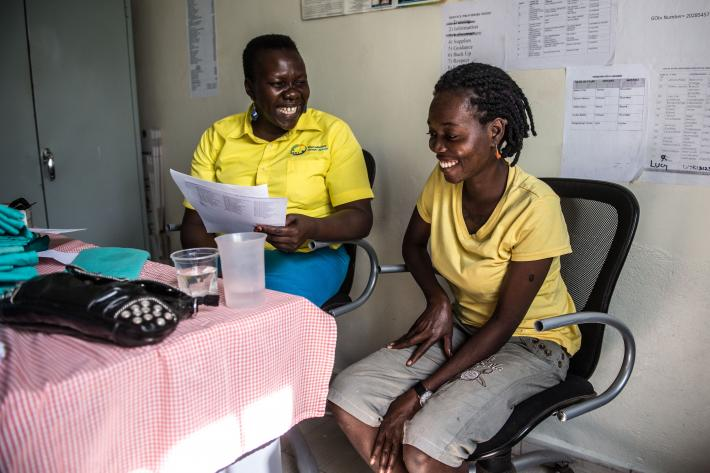 Manager, Anicia Filder, with Monica Akello after Monica tests negative for Hepatitis B.