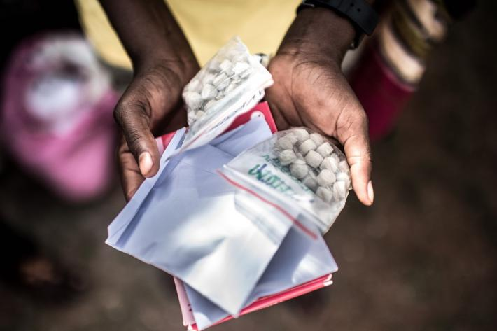 Monica shows the medication she has received from RHU. The ability to receive integrated services in this one stop-shop approach has positively impacted the lives of clients like Monica in Uganda.