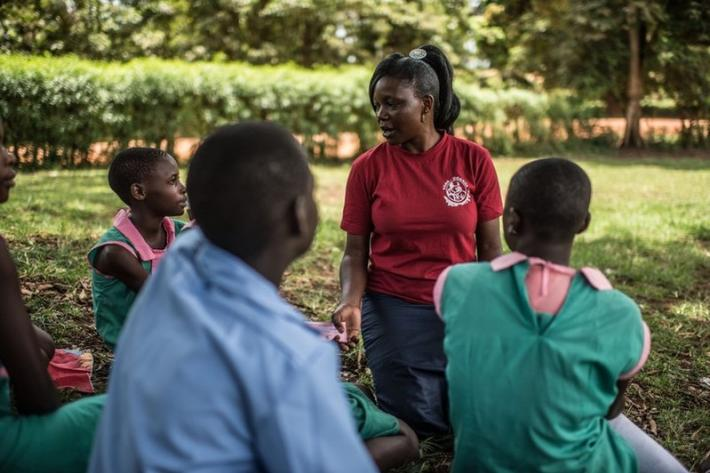 Milly, a teacher and VODA community volunteer, provides information on sexual and reproductive health to pupils at a primary school in Kasawo, Uganda.