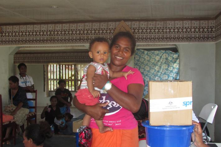 One of the clients of IPPF camp with her child
