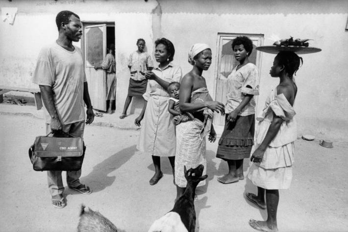 A community outreach officer visiting a local village. Ghana, c1978