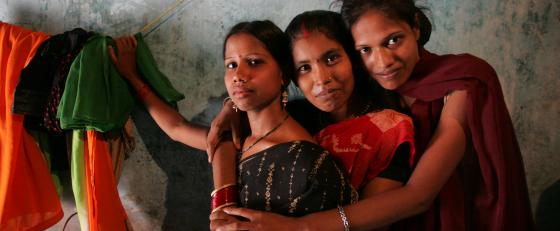 Three Indian girls hugging each other