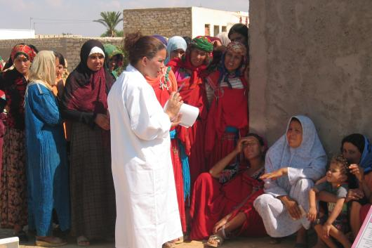 Clinic outreach worker with group of women in Tunisia