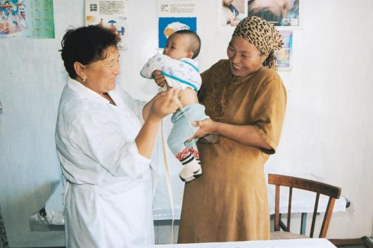 Kyrgyzstan mother and baby with nurse