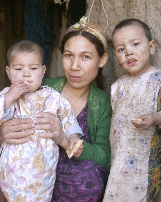 Afghan women and two children