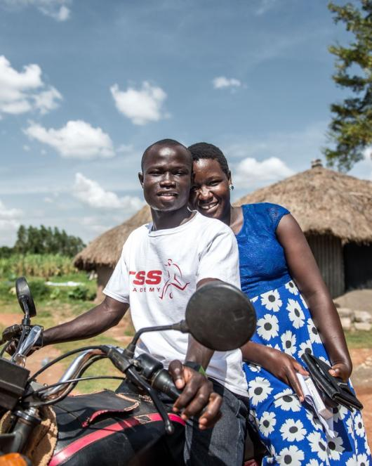 Husband and wife, clients, outside IPPF outreach clinic in rural Uganda