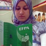 woman reading EFPA's leaflet