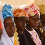 Four black women, looking at the camera. Gambia, ph:Chloe Hall