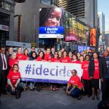 IPPF's I Decide billboard in Time Square with group of supporters