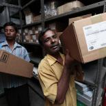 Warehouse workers transporting contraceptive commodities in Bangladesh