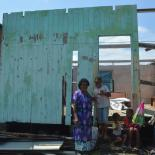Jokaveti in front of her destroyed house